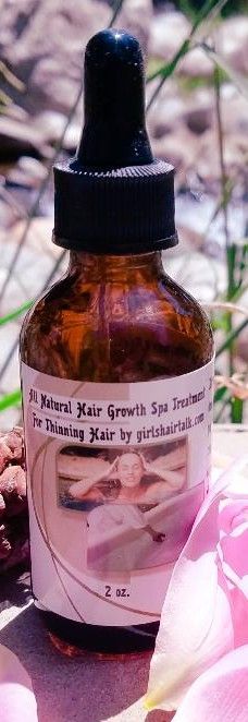 Hair treatment front of bottle close up.