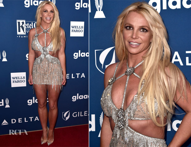 Britney spears in a silver dress on the red carpet.