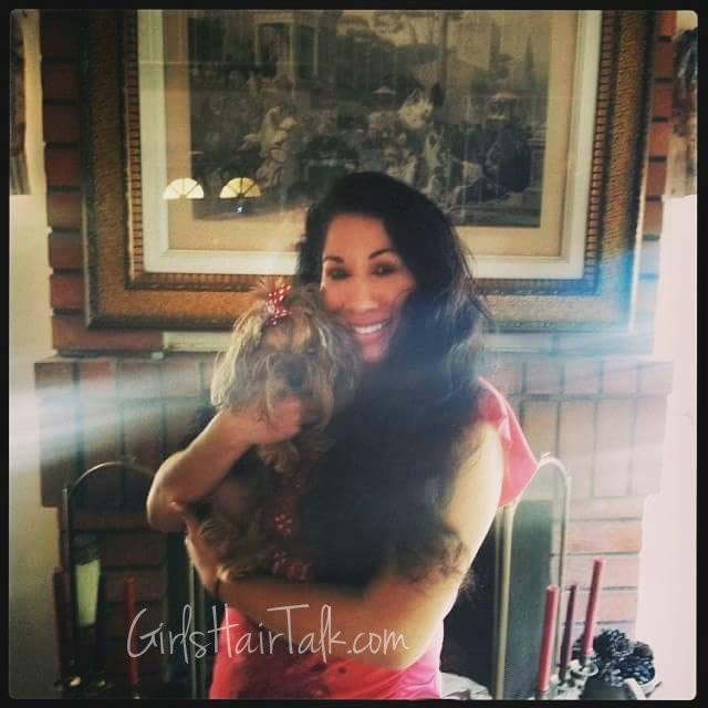 Women holding cute Yorkie dog.