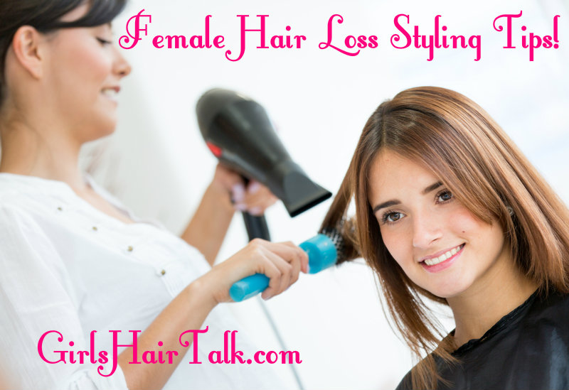 Women smiling getting her hair blow dried from a hairstylist.