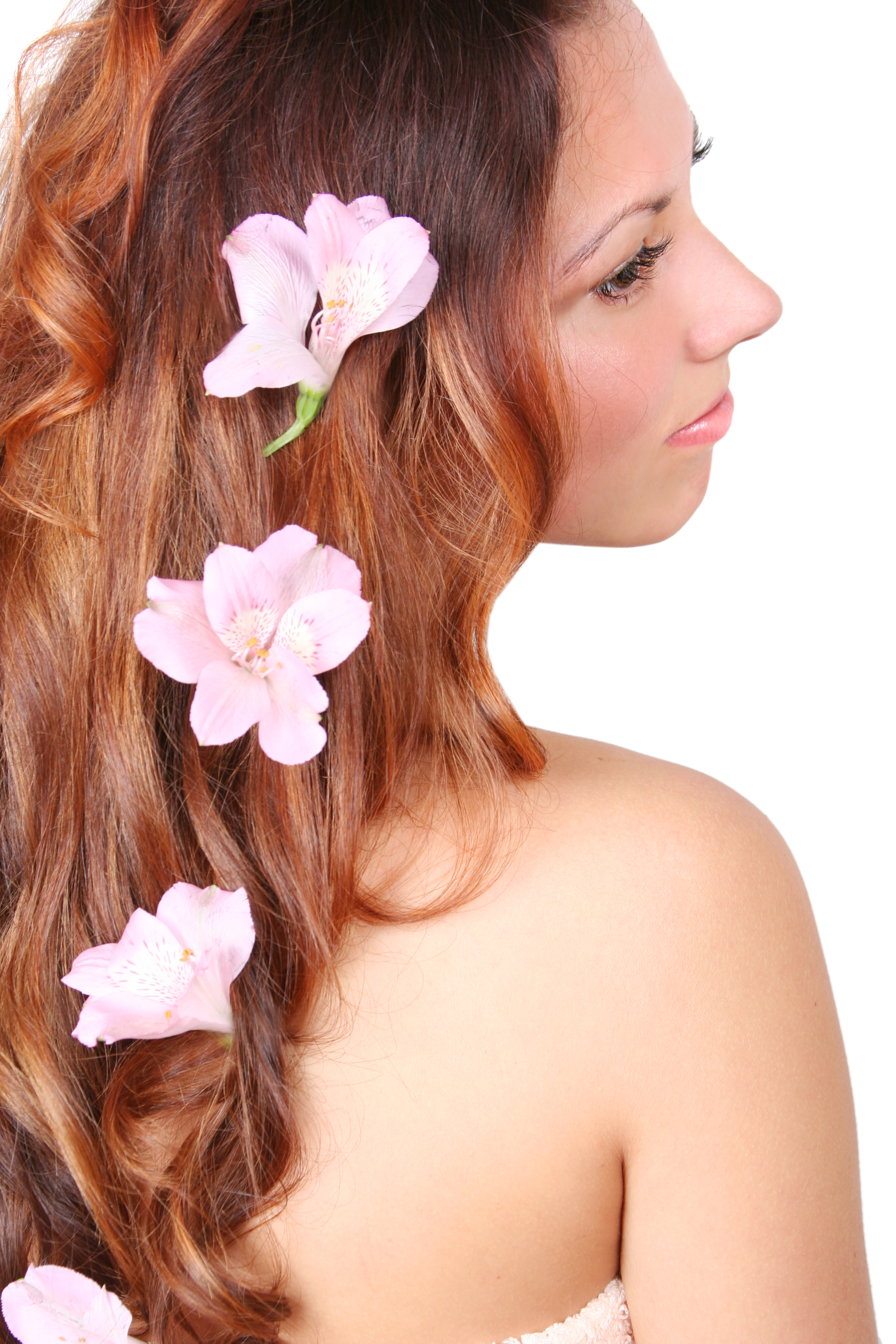 Pretty women with red hair wearing pretty flowers along down her hair.