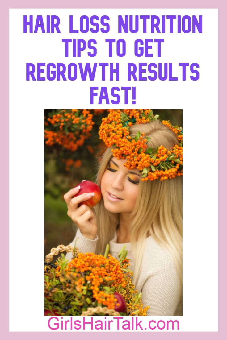 Women wearing little orange flowers as a flower crown on hair and eyes closed while holding a piece of fruit.