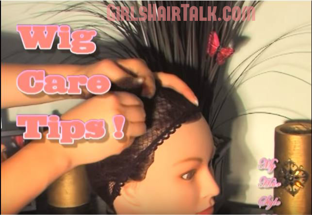 A pair of hands applying a wig cap on a manikin head before applying the wig.